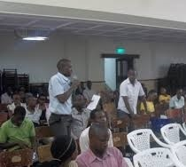 A participant asking a question during the public lecture